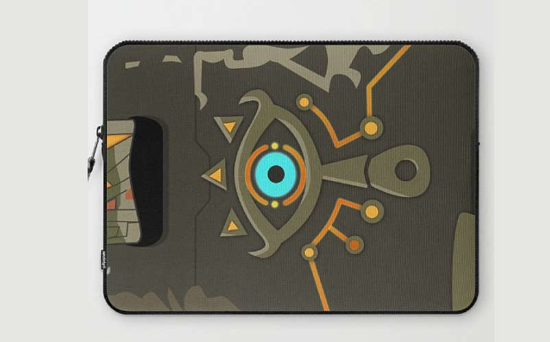 The Sheikah eye with a unique design on a laptop sleeve is perfect for ...